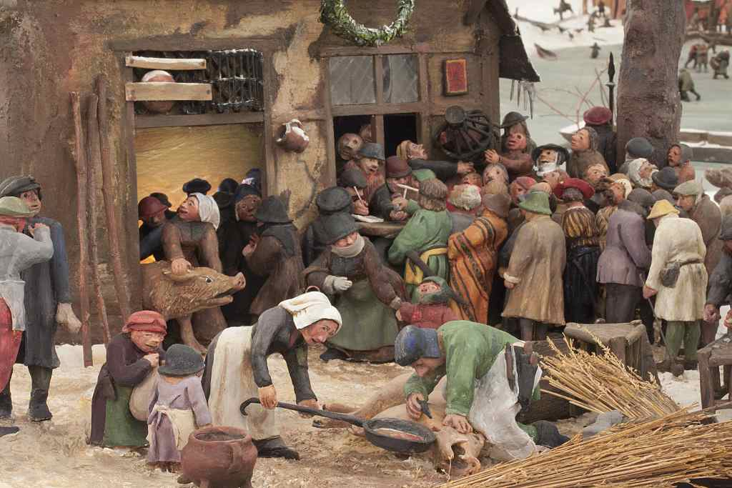 """Winterlandschaft, Figuren schlachten Schwein, Kunstprojekt nach Pieter Brueghel von Martina Singer. Detailaufnahme von der """"Volkszählung zu Bethlehem""""."""