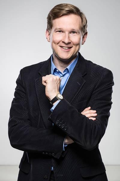Porträt von Dr. Harald Klinke, lächelnd, überzeugt und positiv wirkend.