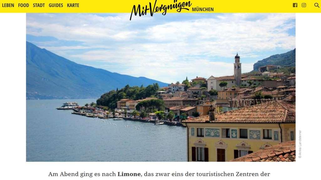 Screenshot von Mit Vergnügen München. Foto mit Panaorama des Gardasees.