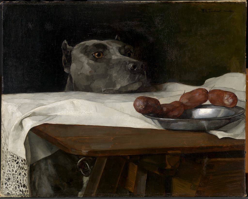 Kulinarische Entdeckungsreisen in Stillleben. Hier ein Detail von einem Hund, dessen Kopf über die Tischkante lugt, die Würstchen auf dem Teller im Blick. Prunkstillleben von Wilhelm Trübner, Cäsar am Rubikon, um 1880. © Staatliche Kunsthalle Karlsruhe. Gastbeitrag zur Blogparade SchlossGenuss